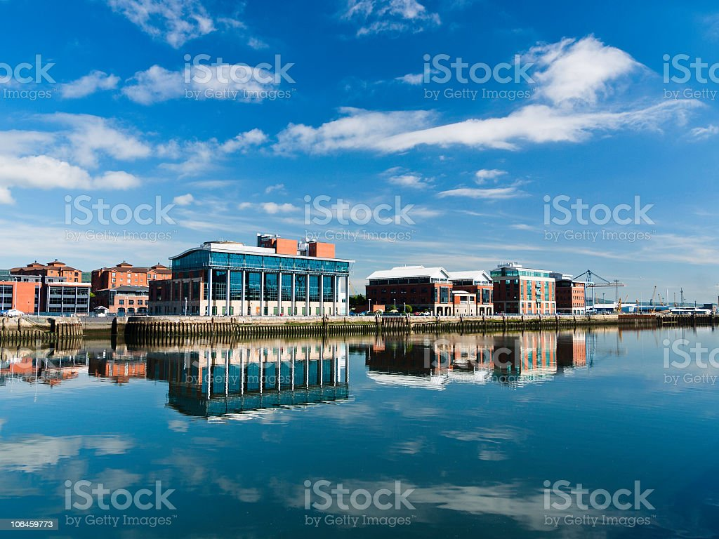 Reflected waterfront hall beside Lagan river Ireland stock photo