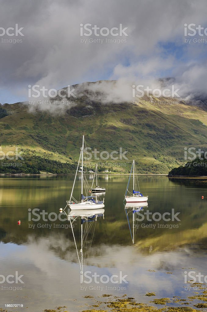 Reflected yachts in Loch Leven stock photo