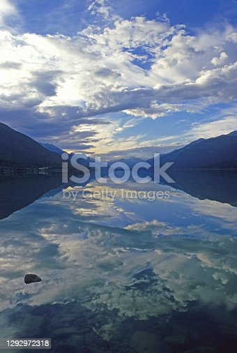An early morning reflection in Moose Lake in Mount Robson Provincial Park, British Columbia, Canada.