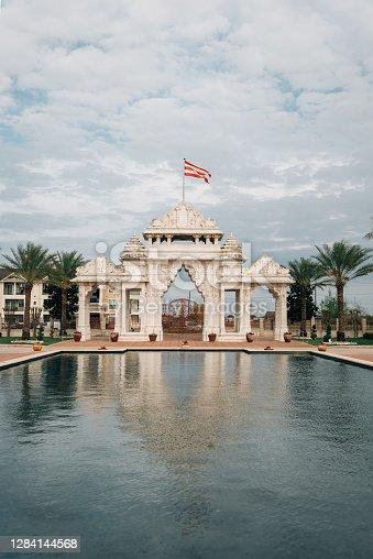 istock Reflecting pool and gate at the BAPS Shri Swaminarayan Mandir Hindu temple, in Houston, Texas 1284144568