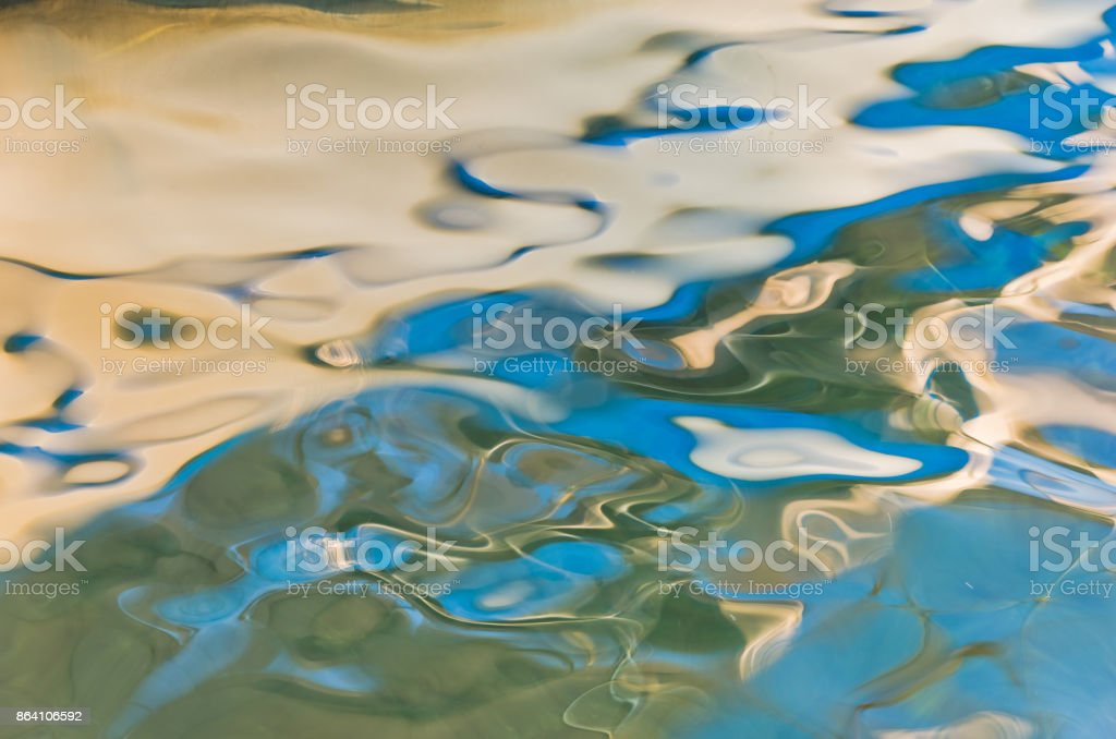 Reflection as a liquid abstraction painted by the sea, sun and wind in Sithonia royalty-free stock photo