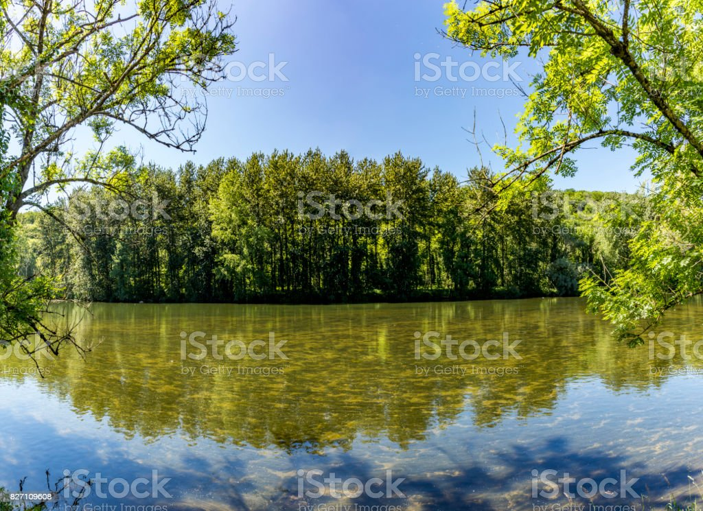 reflection at river Doubs in France stock photo