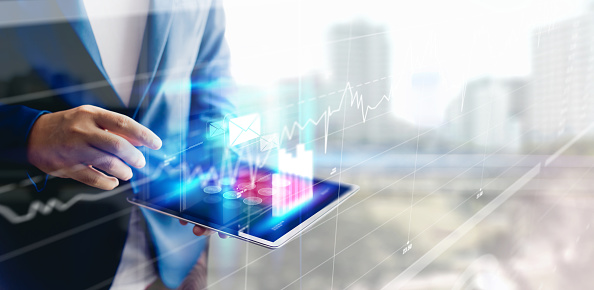 1025744818 istock photo Reflection Businessman using tablet analyzing data and economic growth graph chart. Concept on tablet with hologram. 1148648362