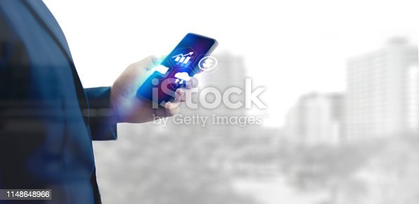 1025744818 istock photo Reflection Businessman using tablet analyzing data and economic growth graph chart  and copy space. Concept on tablet with hologram. 1148648966