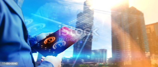 1025744818 istock photo Reflection Businessman using tablet analyzing data and economic growth graph chart. Concept on tablet with hologram. 1148648990