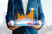 istock Reflection Businessman using tablet analyzing data and economic growth graph chart. Concept on tablet with hologram. 1148649071