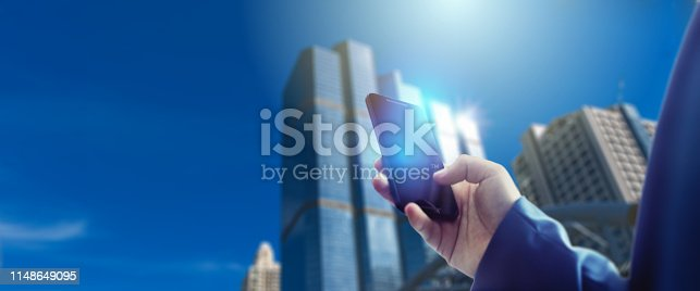 1025744818 istock photo Reflection Businessman using tablet analyzing data and economic growth graph chart  and copy space. Concept on tablet with hologram. 1148649095