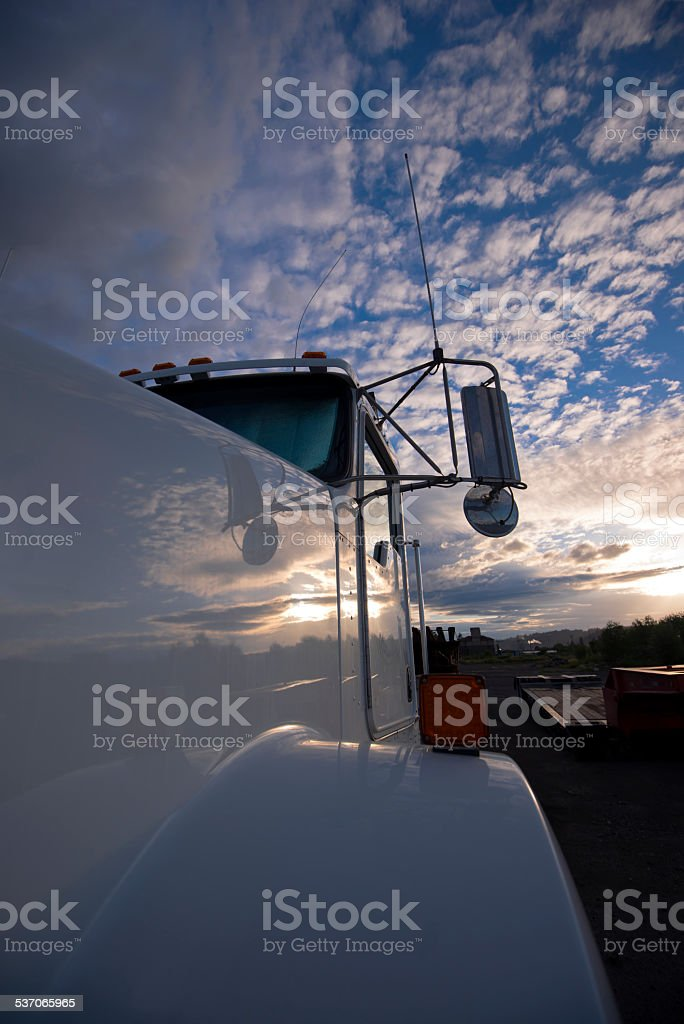 Reflection cloudy sky on cab white classic powerful truck stock photo