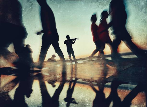 Reflection effect of the man play violin in the street