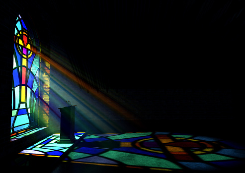 A reflection from a stained glass window of a church