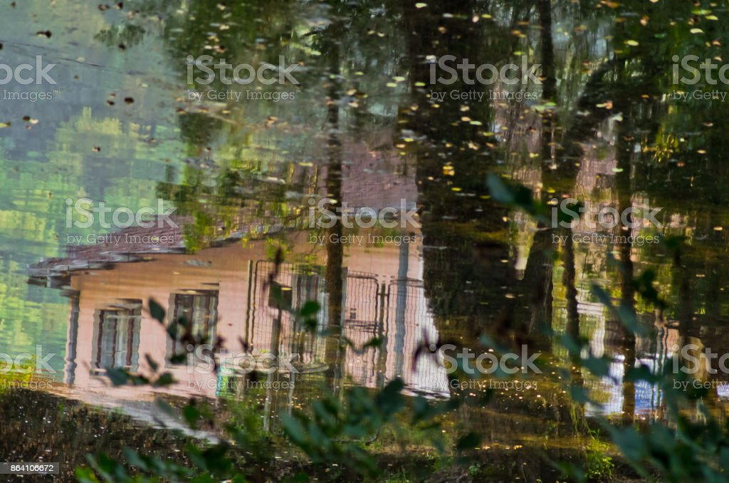 Reflection in a river as an aquarell of a village life at sunset, near Valjevo royalty-free stock photo