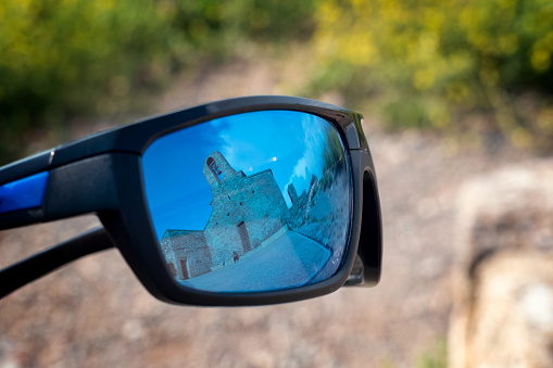 reflection in blue glasses of mountain monastery