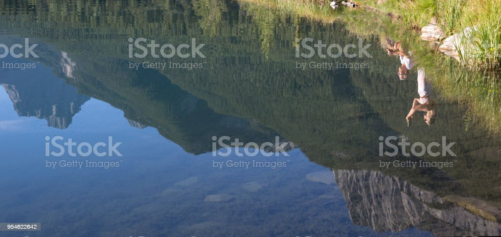 They are reflected in Quarry Lake with the mountains, Canmore