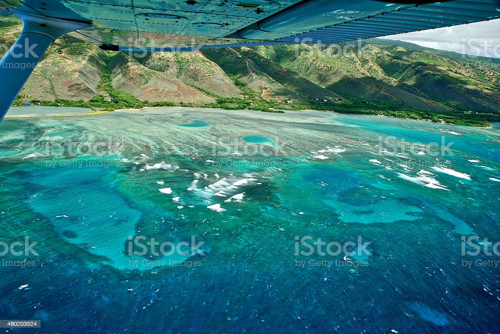 Reflection in Plane Wing of Reef South Side of Molokai stock photo