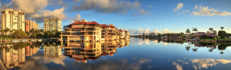 istock Reflection in the water of buildings along the Village at Venetian Bay 1040100984