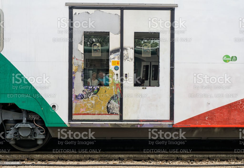 Reflection in train window at Ferrara train station stock photo