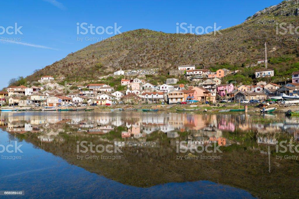 Reflection in water of village Vranjina in Montenegro. stock photo