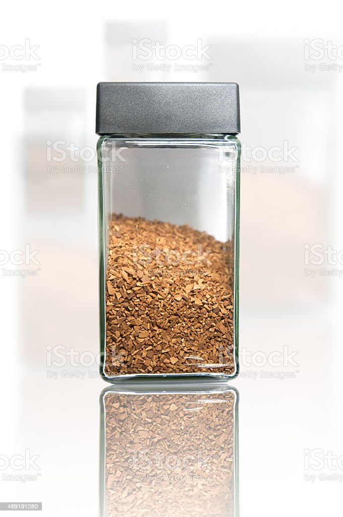 Reflection instant coffee bottle stock photo