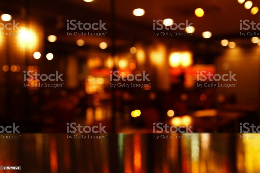 reflection light on table in bar and pub at night stock photo