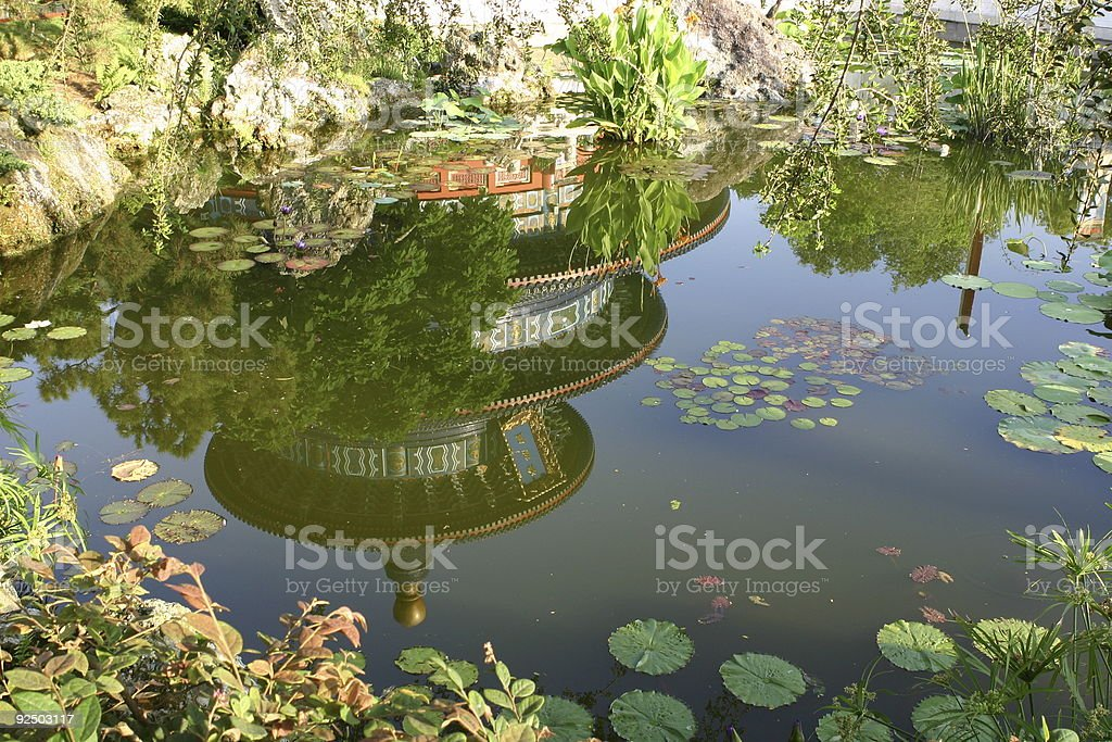 reflection of a Chinese temple on a pond royalty-free stock photo
