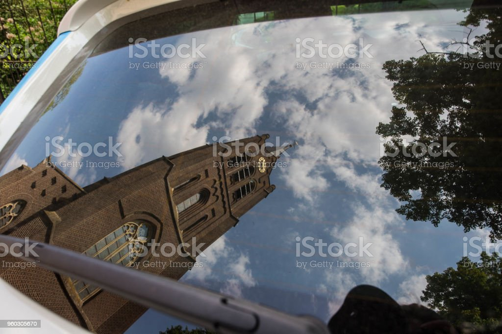 Reflection of a Church in the Netherlands in the car mirror. stock photo