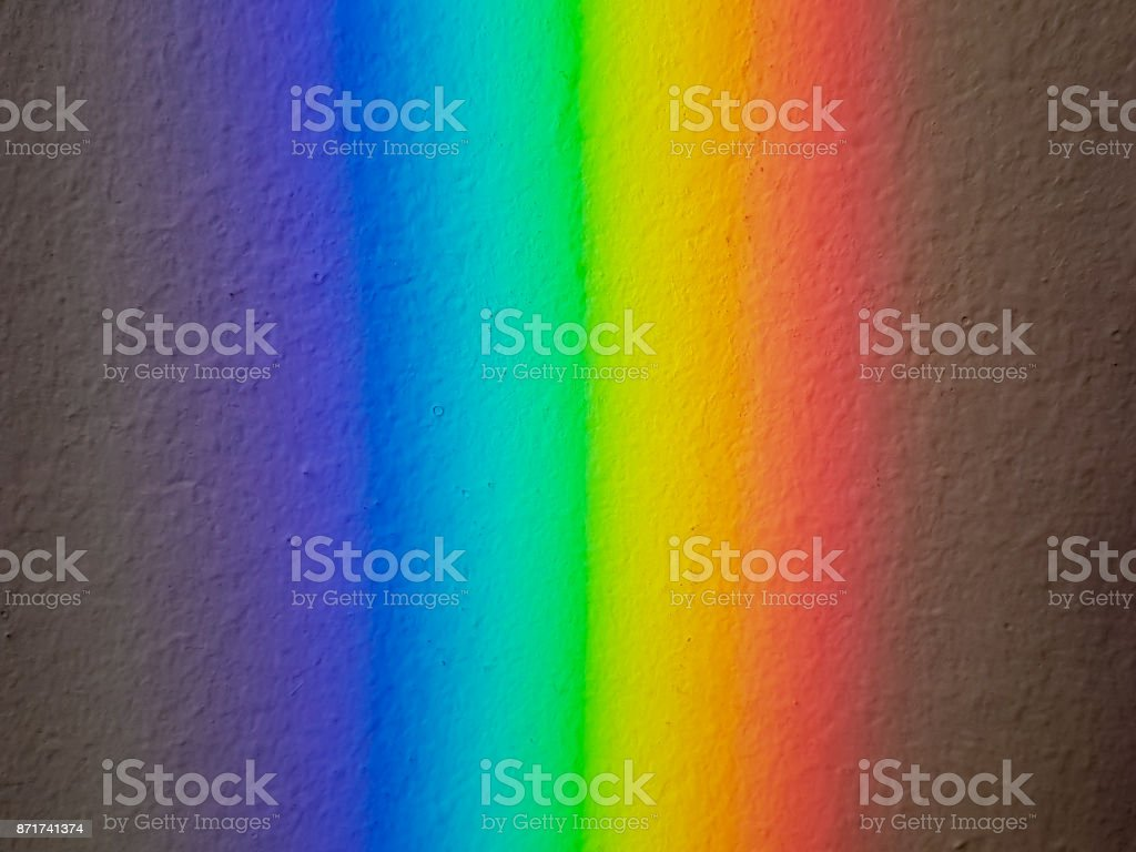 Reflection of a rainbow on the wall stock photo