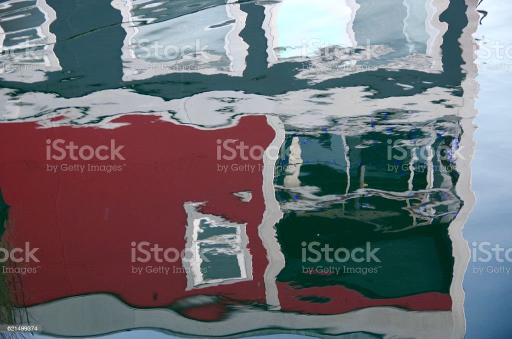 Reflection of a red and grey boathouse photo libre de droits