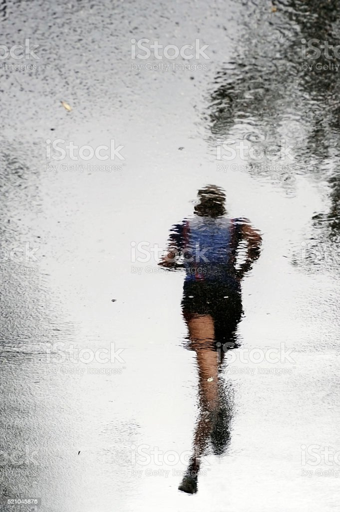 Reflection of a runner stock photo