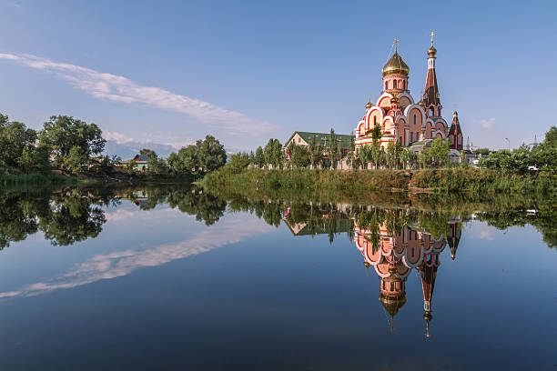 Reflection of a Russian orthodox church in water, in Almaty, Kazakhstan Orthodox church in Almaty, Kazakhstan kazakhstan stock pictures, royalty-free photos & images