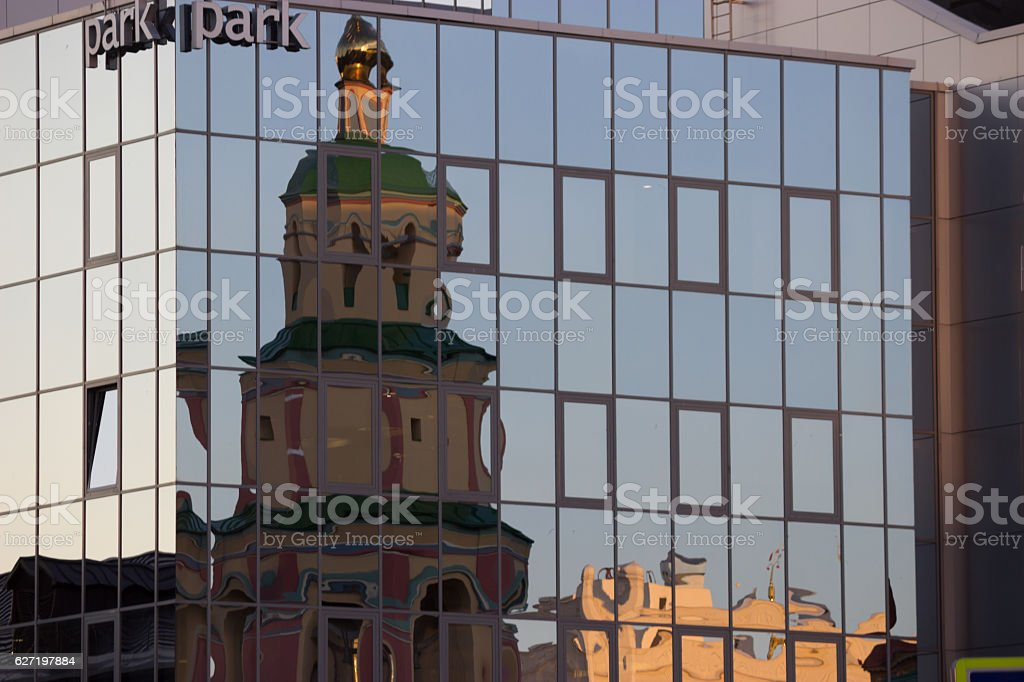 reflection of an old church in a modern building stock photo