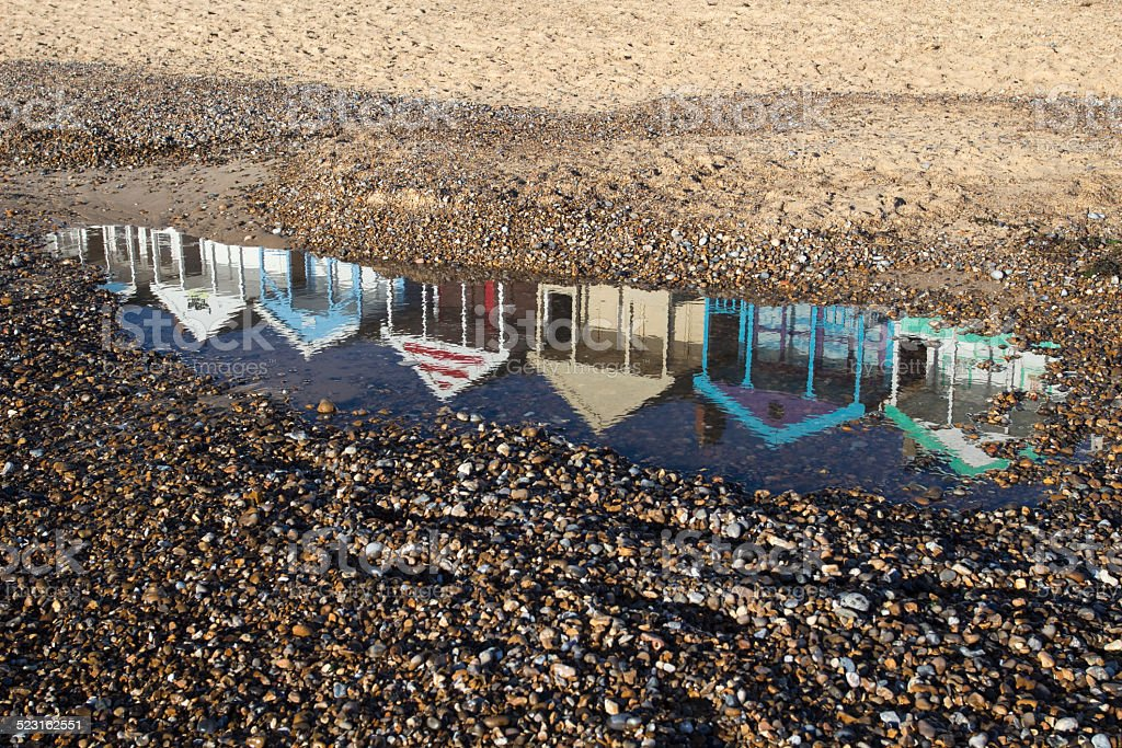 Reflection of Beach Huts on Southwold Beach, Suffolk, England stock photo