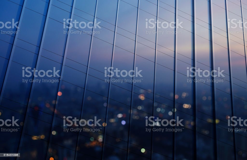 Reflection of blurred aerial view of cityscape in metal wall stock photo