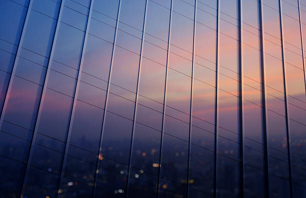 Reflection of blurred cityscape in metal wall of office building stock photo