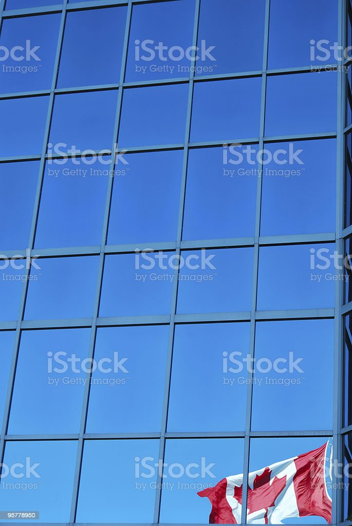 Reflection of Canadian Flag in Office Tower Windows royalty-free stock photo