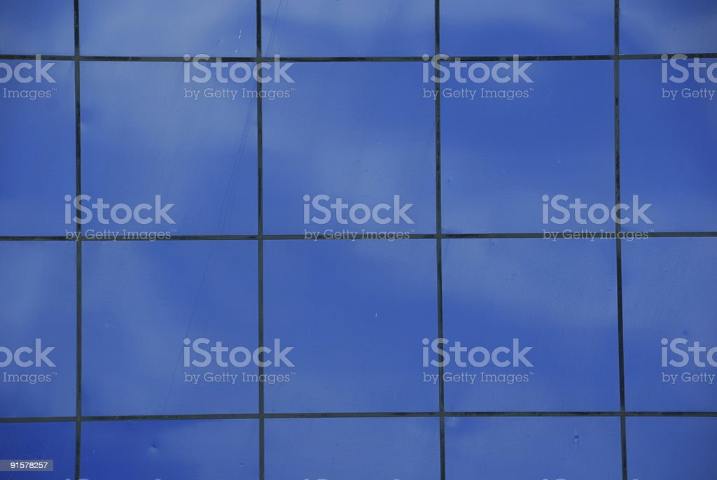 Reflection of Clouds on a Blue Wall royalty-free stock photo