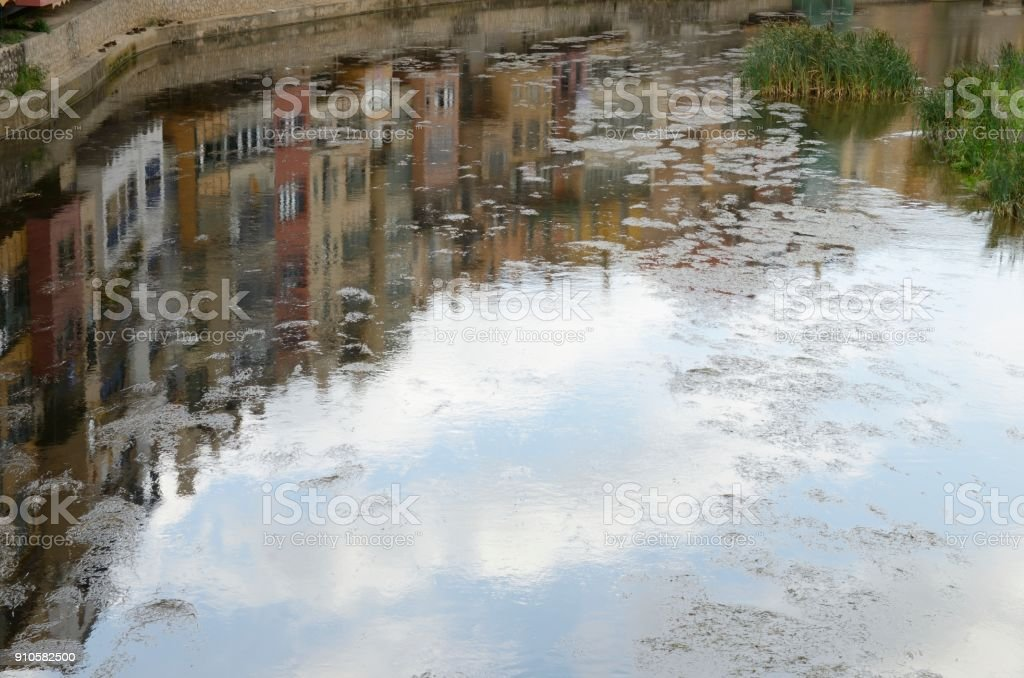 Reflection of color houses in river stock photo