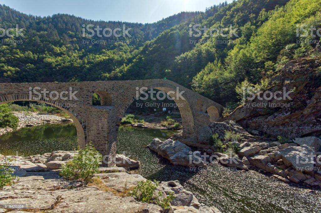 Reflection of Devil's Bridge in Arda river and Rhodopes mountain, Kardzhali Region, Bulgaria stock photo