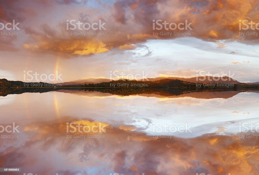Reflection of dramatic and colorful sunset clouds royalty-free stock photo