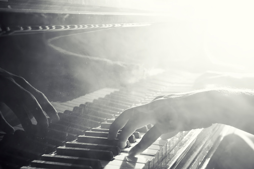 Reflection of hand playing the piano