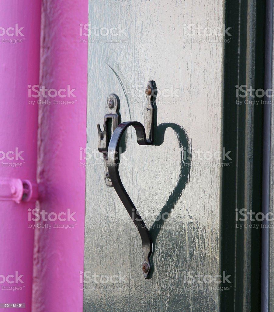 reflection of handle of the heart-shaped balcony stock photo