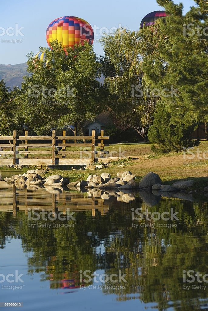 Reflection of hot air balloons in the lake royalty-free stock photo
