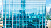 istock Reflection of jakarta cityscape on an office building 935217958