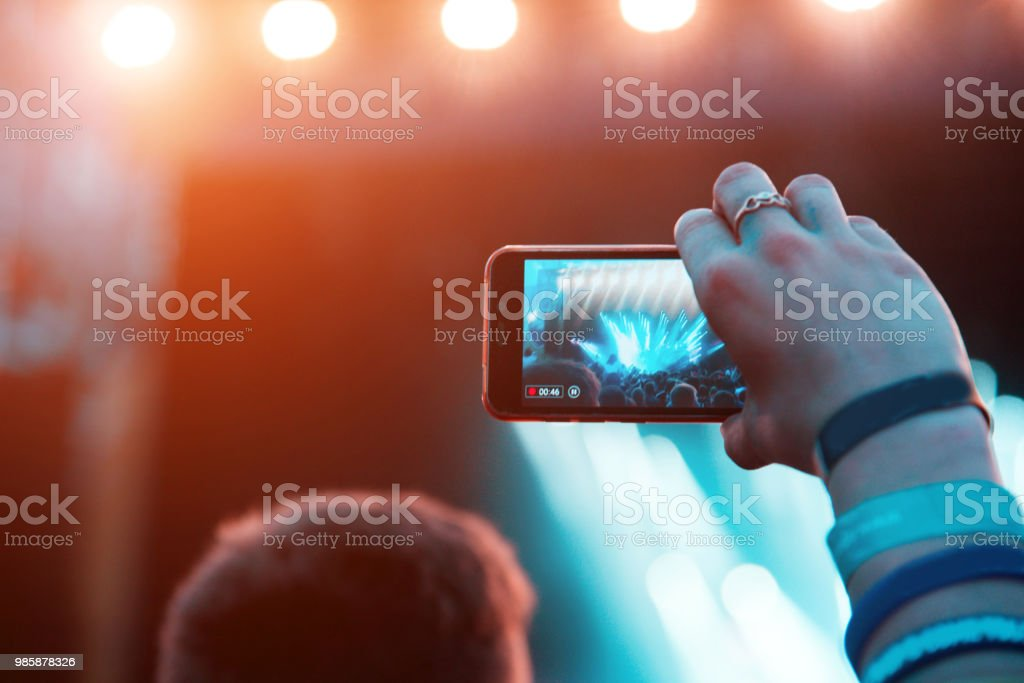 Reflection of light effects on mobile phone at a concert