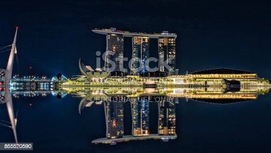 istock Reflection of Marina bay sand with Helix bridge at twilight in Singapore city 855520590