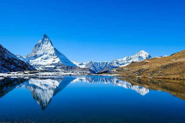 Reflection of Matterhorn in lake during autumn,zermatt, Switzerland Reflection of Matterhorn in lake during autumn,zermatt, Switzerland zermatt stock pictures, royalty-free photos & images