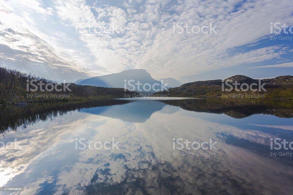 Reflection of Mount Vassitjåkka stock photo