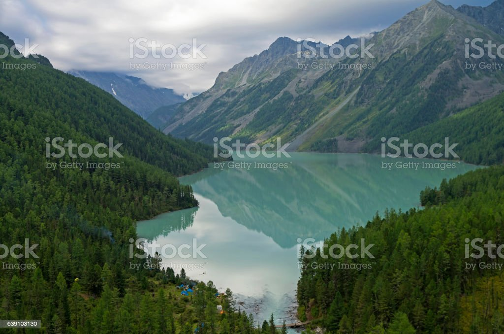 Reflection of mountains in the lake. Kucherla lake. Altai Mounta stock photo