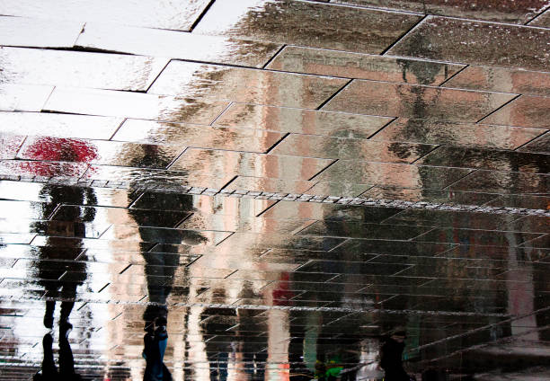 reflection of people in rainy street - impressionist painting stock photos and pictures
