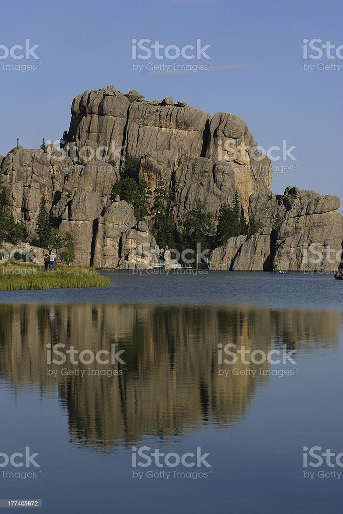 Reflection of rocks in the water royalty-free stock photo
