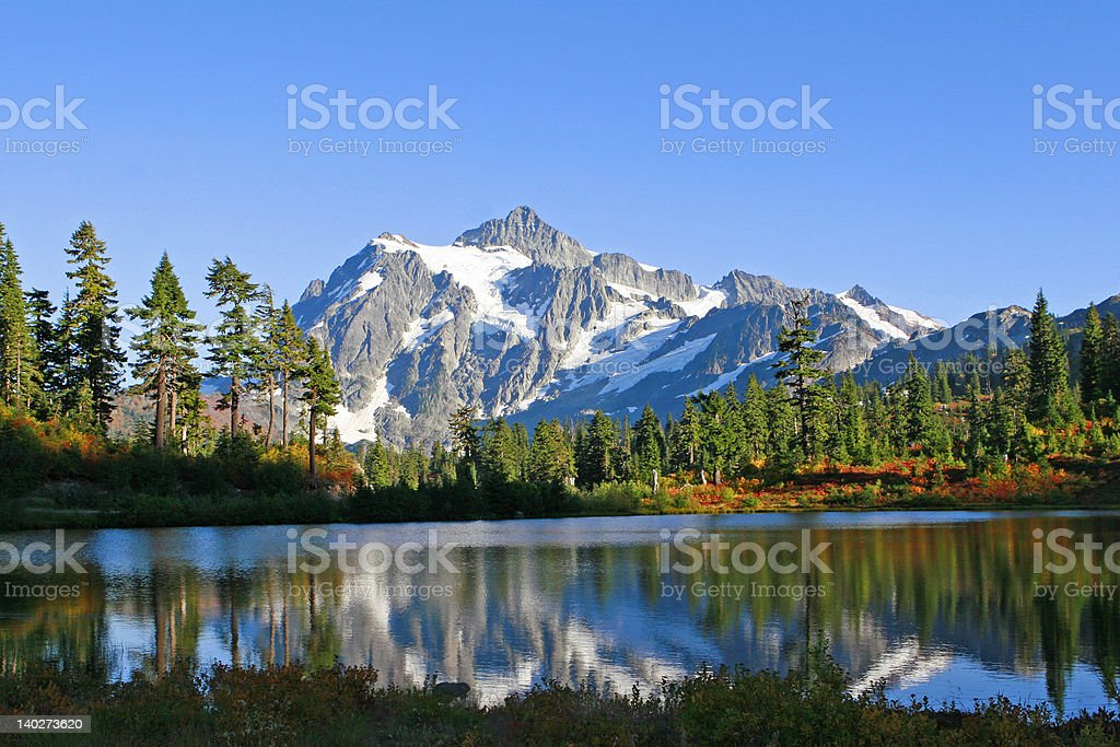 Reflection of Rugged Mountain Peak stock photo